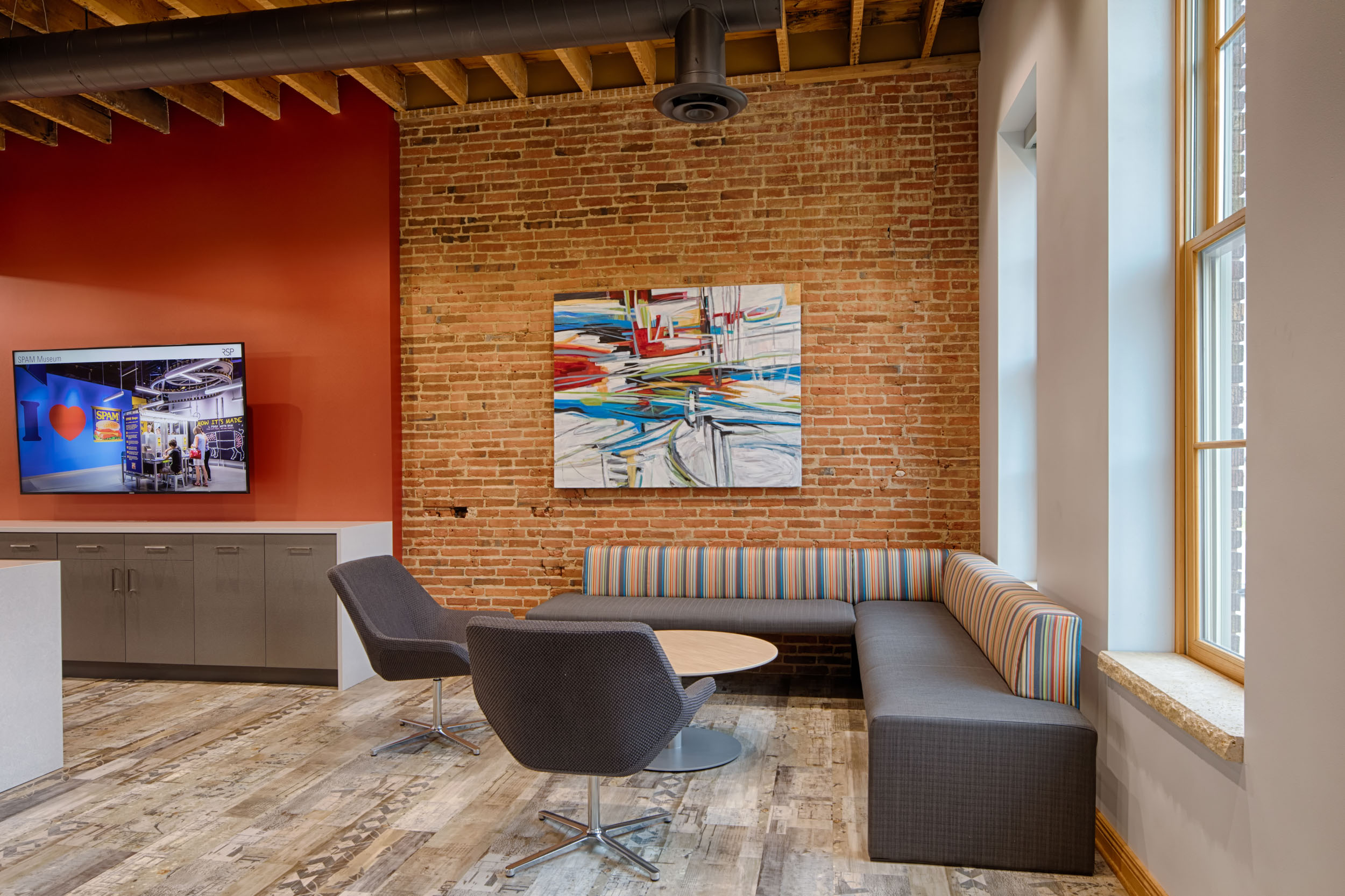 Contemporary office design with exposed brick architecture photography by Silverman Be Remarkable